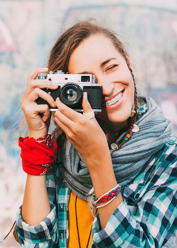 Girl with camera and traditional braces